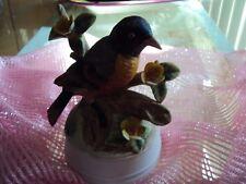 MUSIC BOX.  BIRD ON A BRANCH  MILANE PORCLAIN SCULPTURE. BY EDA MANN.