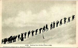 Postcard AK Men Carrying Heavy Packs Over Chilkott Pass in 1898 ~1910 M48