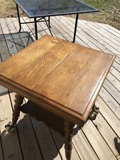 Antique Parlor Table with extra large brass claw foot Rope Legs Scalloped Shelf