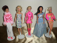 Lot of 5 dressed Mattel Barbie dolls in gently used Condition.