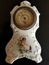 antique porcelain clock mantle shelf boudoir parlor, cupid dueling a beetle
