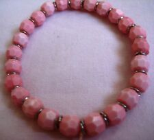 Beads separated by silver tone spacers Vtge Stretch Bracelet Pink faceted Lucite