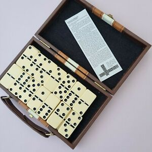 Travel Dominoes game with leather case and instructions