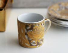Servizio da caffè in porcellana colore oro, nuovo con imballo originale.