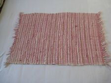 Rag rug in shades of pink and white cotton fabric
