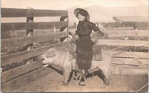 RPPC Farm Scene Cowgirl Riding Saddled Pig in Corral early 1900s NEAT PHOTO!!