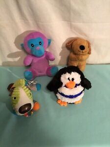 LOT OF 4 DOG PUPPIE PLUSH TOYS PENGUIN, PUPPY, DOG WITH RATTLES, PURPLE BEAR
