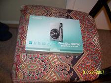 very nice digital camera  {by canon}