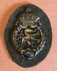 WWI era, 1914-1915 Patinaed Metal, Dragon & Crown army sleeve badge British