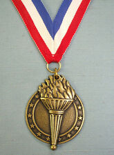 high relief gold torch victory medal with patriotic neck ribbon