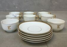 Limoges France porcelain 7 tea cups with monogram E / 5 saucers white and gold.;