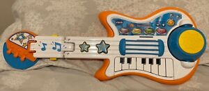 V- tech battery operated toy guitar
