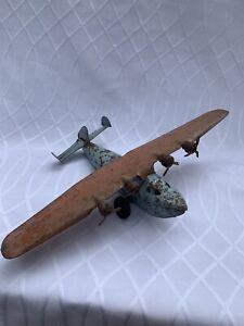 antique metal tin toy airplane