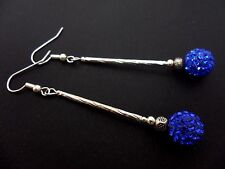 A PAIR OF LONG DANGLY BLUE SHAMBALLA STYLE  SILVER PLATED EARRINGS.