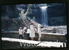 1960s  Kodachrome Photo slide People at waterfall  Back to camera
