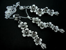 A TIBETAN SILVER FLOWER THEMED NECKLACE AND  CLIP ON EARRING SET. NEW.