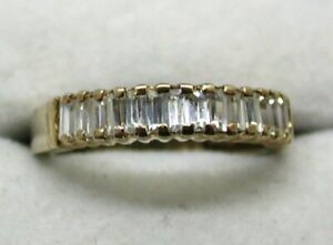 9 carat Gold And Baguette Cut Cubic Zirconia Half Eternity Style Ring Size M
