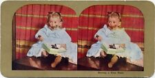 HAVING A FINE TIME VINTAGE PHOTO BABY GIRL EATING CHOCOLATE CANDY STEREOVIEW