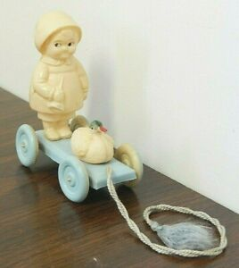 Antique Celluloid Pull Toy w/Girl & Duck Attached to a Blue Cart w/Pull String