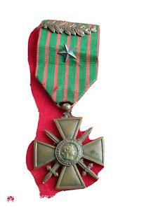 Médaille militaire croix de guerre 1914 1918avec palme et étoile