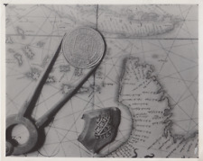 Map and Coin- Press Photo