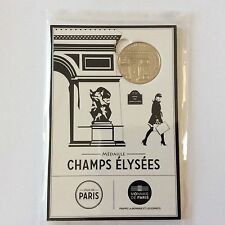 Blister d'une médaille touristique Champs Elysées en cuivre et nickel 2016