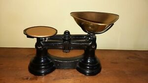 Cast iron scales black with brass pan made in england