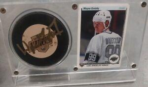 Wayne gretzky card & hockey puck signed.