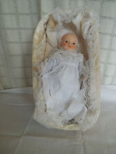 Hand crafted ceramic baby doll with bed