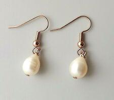 White freshwater cultured pearl teardrop earrings .. rose gold tone jewellery