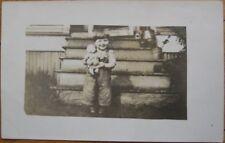 1910 AZO Realphoto Postcard: Little Boy on Steps w/Doll