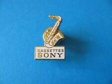 Vintage Sony Cassettes pin badge, Enamel. Saxophone. Sax.