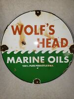 VINTAGE PORCELAIN WOLFS HEAD MARINE OILS GAS AND OIL SIGN '62