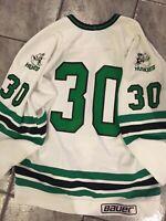 Saskatchewan  Huskies Goalie cut, signed team jersey