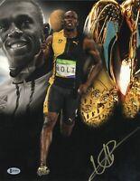 JAMAICA USAIN BOLT SIGNED AUTO OLYMPICS 11X14 PHOTO AUTHENTIC BECKETT BAS COA 22