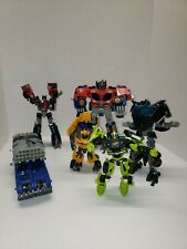 Transformers Lot with 2 optimus prime, bumblebee 3 other autobots.  No weapons