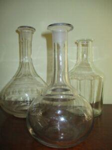 3 Antiche bottiglie in vetro varie forme