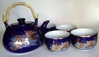 Japanese Porcelain Tea Pot And 4 Cups. Rich Blue With Gold Peacocks And Flowers