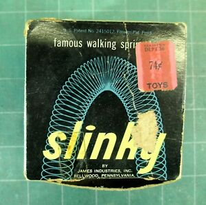 VINTAGE: Slinky with Box - metal - 70s or 80s - price marked 74 cents - James