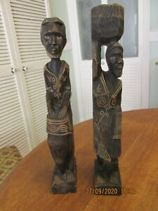 PAIR OF CARVED WOODEN CARRIBEAN TRIBAL ART FIGURES FROM THE DOMINICAN REPUBLIC