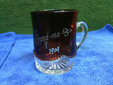 """Depression glass ruby red and clear dated 1909. 3&1/4"""" tall. Nice condition"""