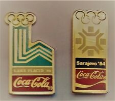 lot de 2 pin's Coca Cola JO Lake Placid 80 et Sarajevo 84