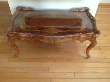 Inlaid wood coffee table with glass top