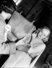 080 JEAN HARLOW CHECKS HER MAKEUP ON THE SET OF SARATOGA PHOTO