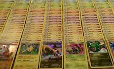 10 pokemon cards (7 random pokemon)(two trainer items)(one reverse) or holo 1/8