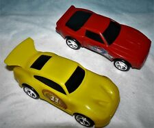 Two PLASTIC FRICTION CAR MODELS One Yellow and one Red