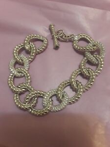 Judith Ripka sterling silver sz curve link bracelet w emerald toggle clasp...
