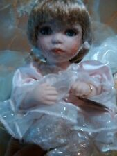 "Geppeddo Poreclain Doll - Tansi Mini Angel - Sitting 6"" Tall."