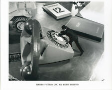 The Avengers TV series 1980's photo Patrick Macnee with giant phone on desk
