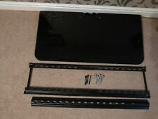 Wall bracket for TV and large black glass shelf which is 81cm wide